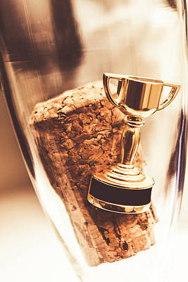 Cork And Trophy Floating In Champagne Flute Art Print