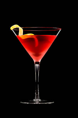 Martini Photos - Cosmopolitan cocktail in front of a black background  by U Schade