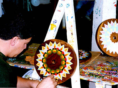 Photograph - Costa Rico - Painting The Animal Cart Wheels by Merton Allen