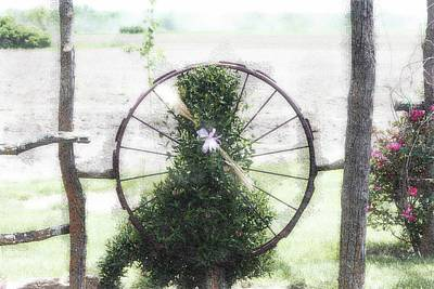 Photograph - Country Ranch Wagon Wheel by Ellen O'Reilly