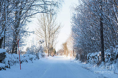 Photograph - Country Road Through A Snowy Winter Landscape by Kennerth and Birgitta Kullman