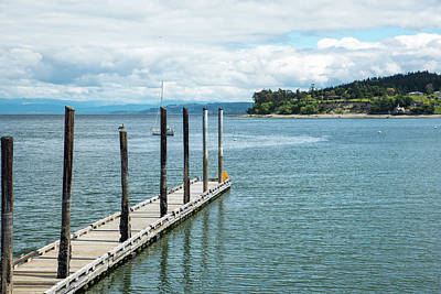 Photograph - Coupeville Dock Under Spring Clouds by Tom Cochran
