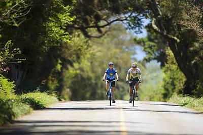 Couple Enjoying A Back Road Bike Ride Art Print