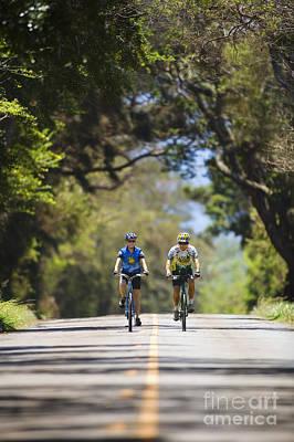 Couple Enjoying A Bike Ride Art Print