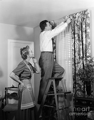 Couple Hanging New Drapes, C.1950s Art Print by H. Armstrong Roberts/ClassicStock