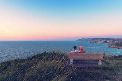 couple on bench vith view of Sopelana coast Art Print by Mikel Martinez de Osaba