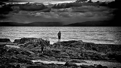 Photograph - Couple On The Sea Rocks by Joseph Hollingsworth
