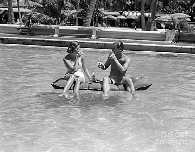 Photograph - Couple Relaxing In Pool, C.1930-40s by H Armstrong Roberts and ClassicStock