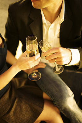 Champagne Glasses Photograph - Couple Sitting, Clinking Champagne by Gillham Studios
