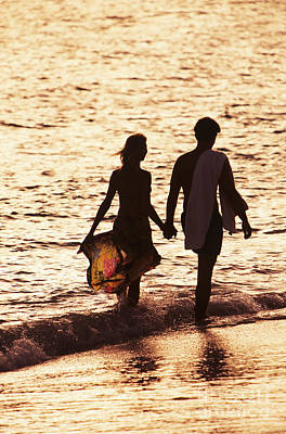 Couple Wading In Ocean Art Print by Larry Dale Gordon - Printscapes