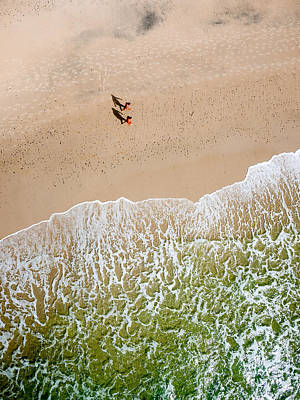 Photograph - Couple Walking On Tallow Beach by Rob Huntley