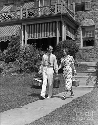 Photograph - Couple Walking Out Of House, C.1930s by H. Armstrong Roberts/ClassicStock