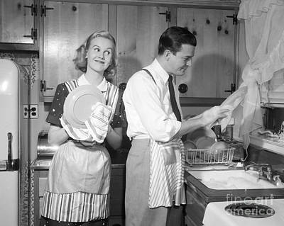 Photograph - Couple Washing Dishes And Smiling by Debrocke ClassicStock