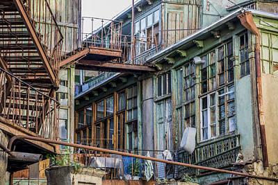 Tbilisi Photograph - Courtyard Of Chaos by John Grummitt