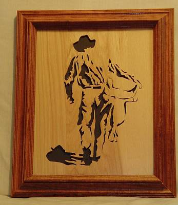 Scroll Saw Sculpture - Cowboy And Saddle by Russell Ellingsworth
