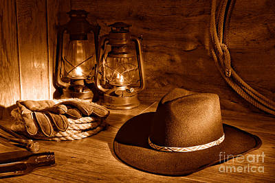 Stetson Photograph - Cowboy Hat And Kerosene Lanterns - Sepia by Olivier Le Queinec