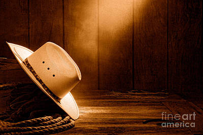 Cowboy Hat In The Old Barn - Sepia Print by Olivier Le Queinec
