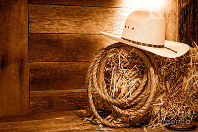 Cowboy Hat On Hay Bale - Sepia Print by Olivier Le Queinec