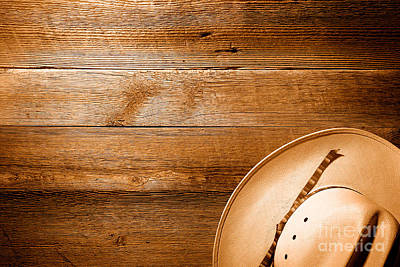Photograph - Cowboy Hat On Wood Table - Sepia by Olivier Le Queinec