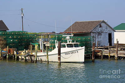Photograph - Crab Pots Beside A Shanty And Deadrise Workboat On Tangier Island by Louise Heusinkveld