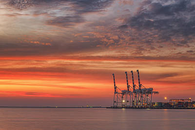 cranes and industrial cargo ships in Varna port at sunset Art Print by Anek Suwannaphoom