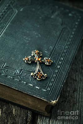 Cross On Bible Art Print by Mythja Photography