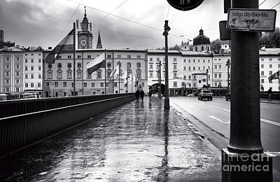 Crossing The Bridge In Salzburg Art Print by John Rizzuto