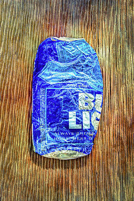 Beer Royalty-Free and Rights-Managed Images - Crushed Blue Beer Can on Plywood by YoPedro