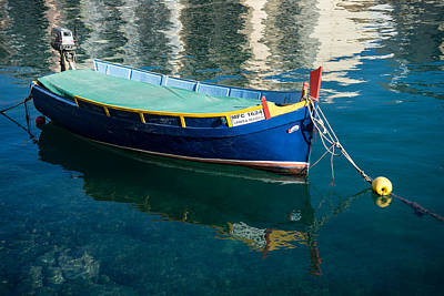Photograph - Crystal Clear Mediterranean Blue - Maltese Luzzu Fishing Boat At Anchor by Georgia Mizuleva