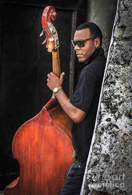 Photograph - Cuban Bass Player by Craig J Satterlee