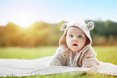 Imagine Photograph - Cute Baby Lying In A Park Wearing Funny Cozy Sweater And Looking Up The Sky by Michal Bednarek