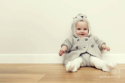 Ear Photograph - Cute Baby Sitting On Wooden Floor. Smiling And Wearing Cozy Sweater. Vintage by Michal Bednarek