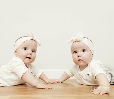Little Sister Photograph - Cute Baby Twin Sisters Crawl Together On Wooden Floor Wearing Funny Headbands by Michal Bednarek