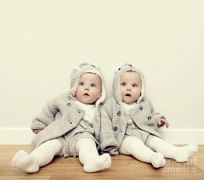 Face Photograph - Cute Baby Twins Sitting On Wooden Floor And Wearing Warm Cozy Sweaters. Vintage by Michal Bednarek