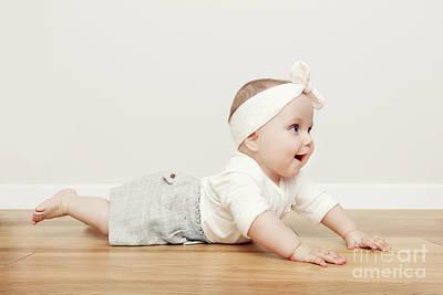 Wooden Photograph - Cute Happy Baby Crawl On Wooden Floor Wearing Funny Headband by Michal Bednarek