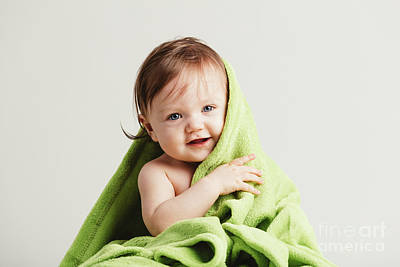 Photograph - Cute Little Baby Leaning Out Of Cozy Green Blanket. by Michal Bednarek
