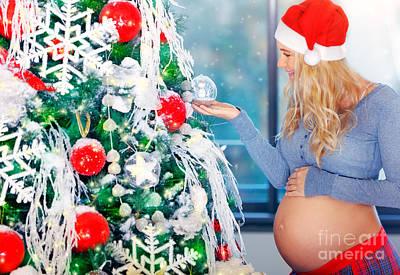 Photograph - Cute Pregnant Woman Adorns Christmas Tree  by Anna Om