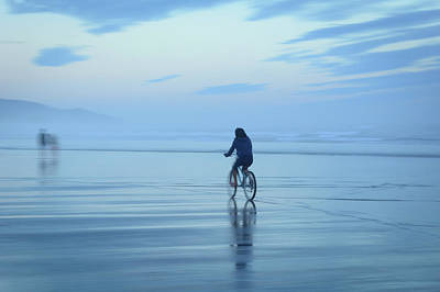 Photograph - Cycling On Cannon Beach by Keith Boone