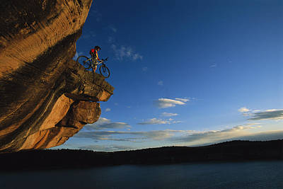 Cyclist Dan Davis Atop A Rock Overhang Print by Bill Hatcher