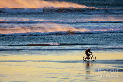 Photograph - Cyclist Pedals Against The Wind At Pismo Beach by Sharon Foelz