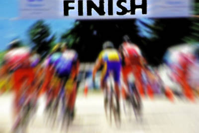 Cyclists Crossing The Finish Line Art Print by Steve Ohlsen