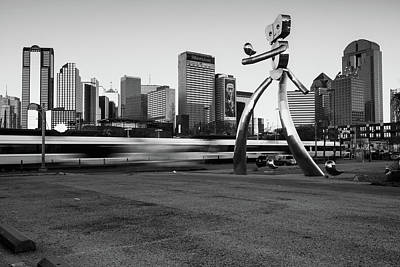Photograph - Dallas Texas Skyline And Traveling Man - Black And White by Gregory Ballos