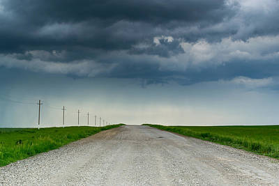 Photograph - Dark Rain Clouds Over Empty Road by John Williams