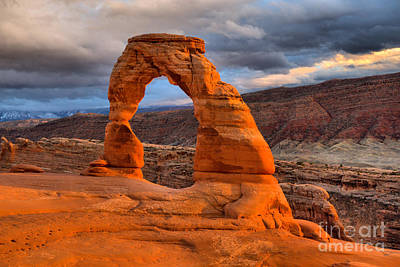 Photograph - Dark Storm Clouds Over Delicate Arch by Adam Jewell