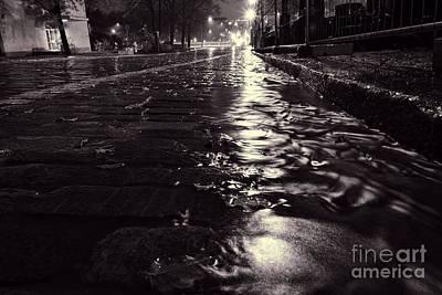 Artistic Photograph - Dark Water Reflecting From Dark Street In The Center Of Helsinki by Mikko Palonkorpi