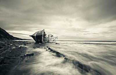 Defeated By The Sea Art Print by Inigo Barandiaran
