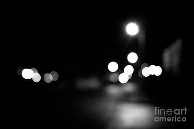 Streetlight Photograph - defocussed streetlights on a dark night in Newtownabbey northern ireland uk by Joe Fox