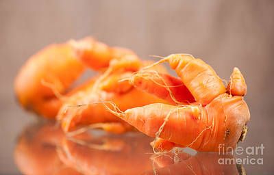 Deformed Carrot Roots With Forks Lying On Glass  Art Print