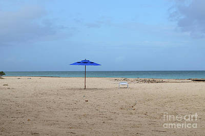 Photograph - Deserted Beach With A Blue Umbrella On A White Sand Beach by DejaVu Designs