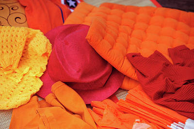 Photograph - Display Of Orange And Red Clothing by Jenny Rainbow